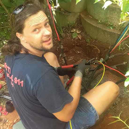 Colin wiring up underground cabling for outdoor wiring and fault finding.