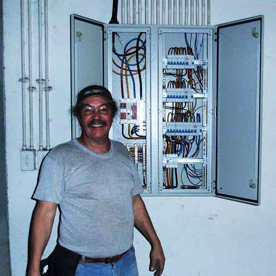 Noel proudly smiling with a 3 phase electrical distribution professionaly completed